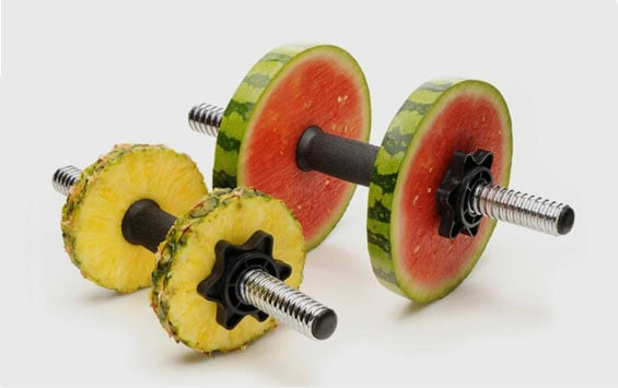 Weights made with melons and pineapples to signify innovation